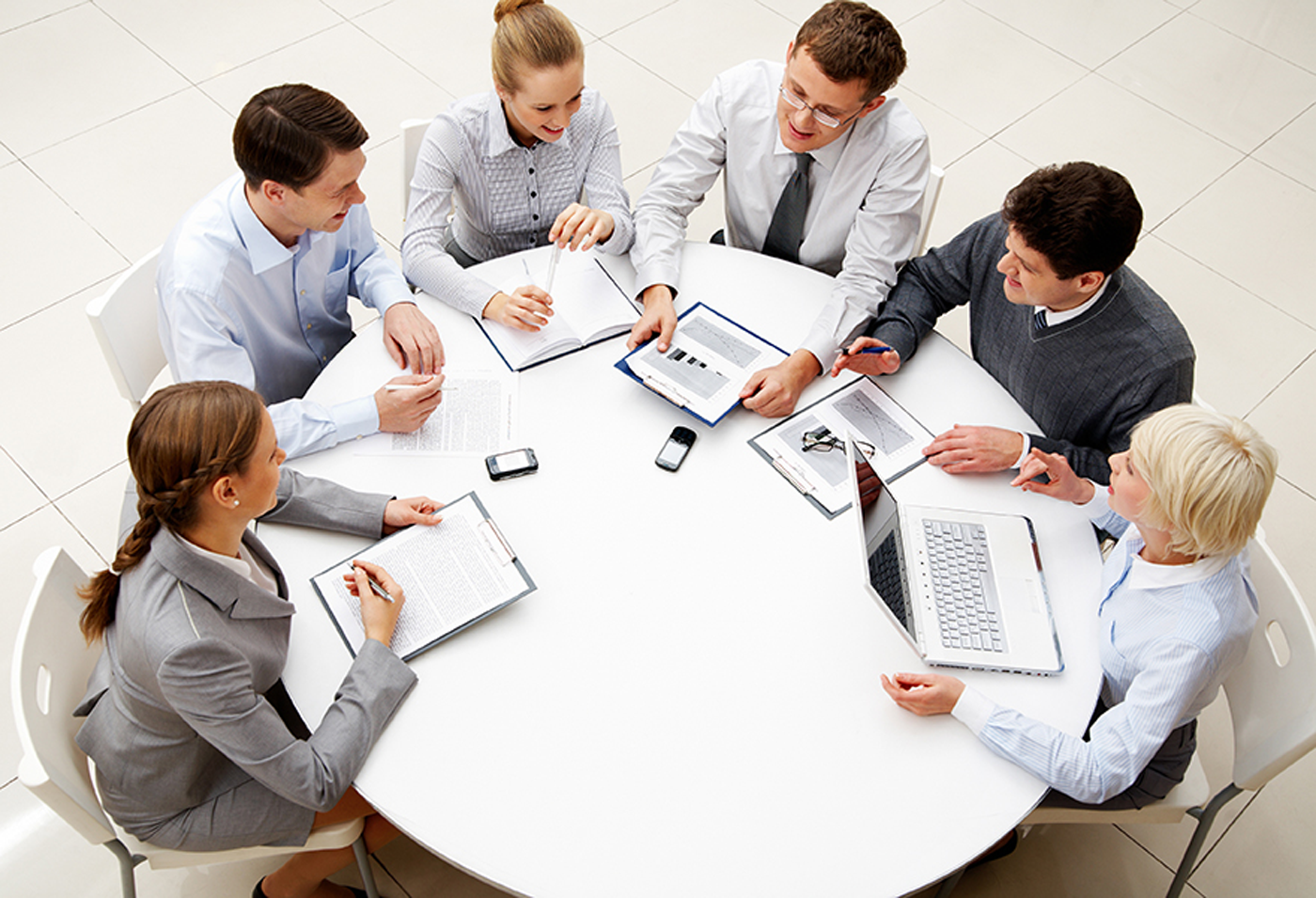 business-meeting-sitting-at-round-table-from-above